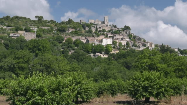 mountain village lacoste with chateau de sade - luberon stock videos & royalty-free footage