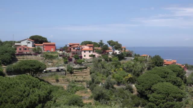pan / mountain village patresi - island of elba stock videos & royalty-free footage
