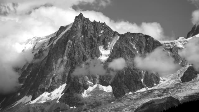 mountain with white clouds, time lapse of clouds moving over mountain and valley, aiguille du midi, french alps - peak tower stock videos and b-roll footage