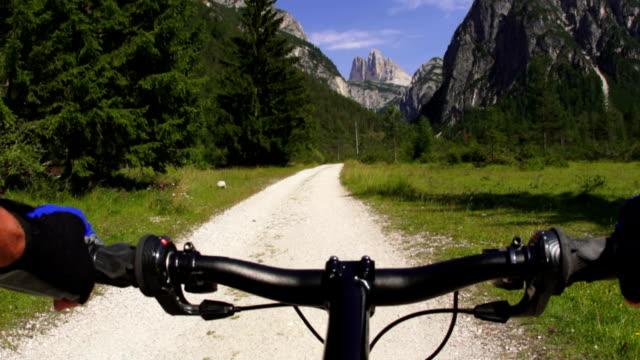 mountainbiker in the dolomites mountains pov - tre cimo di lavaredo stock videos & royalty-free footage