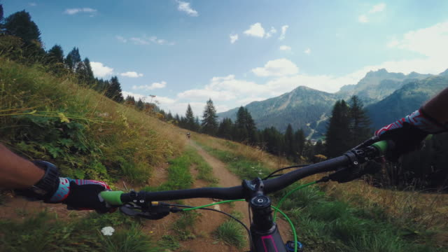 pov mountainbiking action: enduro riding on the alps - wearable camera stock videos & royalty-free footage