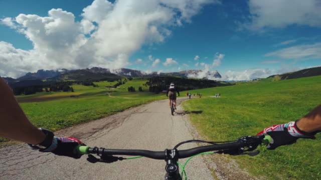 pov mountainbiking action: pedaling with a woman on the alps - wearable camera stock videos & royalty-free footage