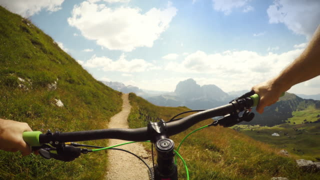 mountainbiking on the dolomites - unesco world heritage site stock videos & royalty-free footage