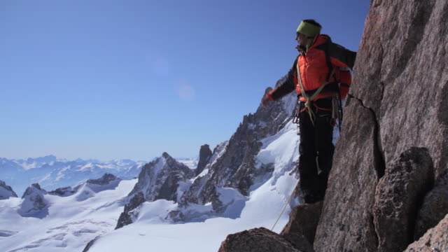 tu mountaineer climbing in high mountains/french alps - 1 minute or greater stock videos & royalty-free footage