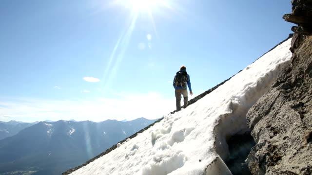 Mountaineer jumps overhead camera