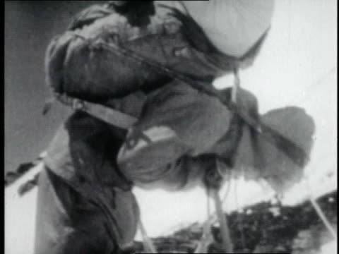 vidéos et rushes de w mountaineer pausing during final assault on mt everest / nepal - 1952
