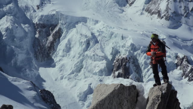 zi  mountaineer using gps  in high mountains/french alps - only mature men stock videos & royalty-free footage