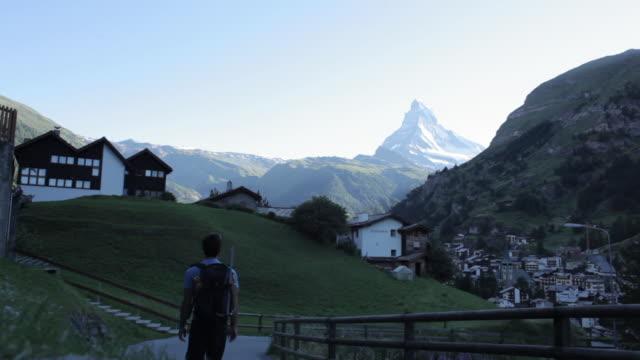 Mountaineer walking into the village of Zermatt in Switzerland.