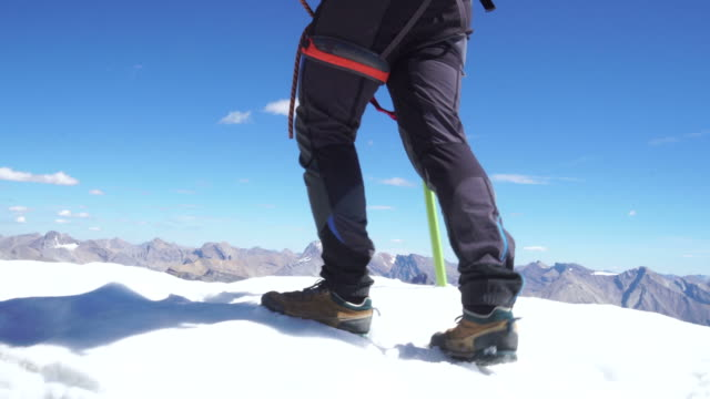 mountaineer walks along cornice - only mature men stock videos & royalty-free footage