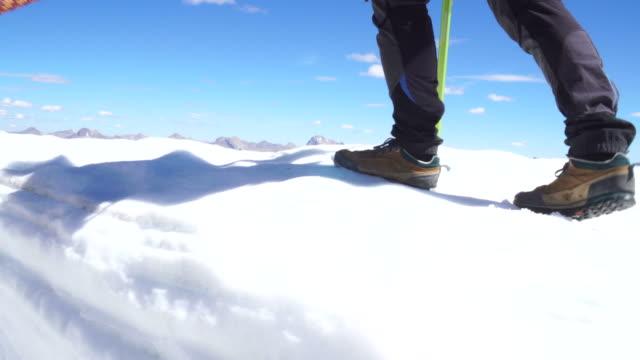 mountaineer walks along cornice - snow cornice stock videos and b-roll footage