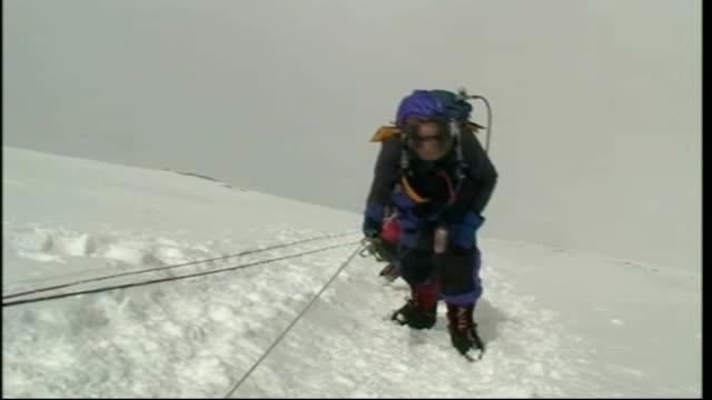 vidéos et rushes de risking it all sir ranulph fiennes everest climb camp 4 nepal himalayas mount everest ext summit of mount everest seen beyond rock face in f/g... - rock face