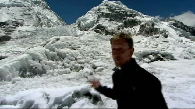 'risking it all' sir ranulph fiennes mission to climb mount everest day one reporter to camera by khumbu icefall - khumbu stock videos and b-roll footage
