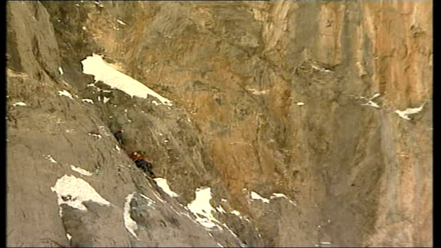 Sir Ranulph Fiennes mission to climb the Eiger Day 3 INT Fiennes climbing mountain PULL OUT reporter to camera