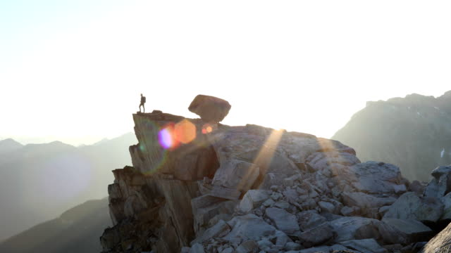 mountaineers approach rugged summit at dawn - on top of stock videos & royalty-free footage