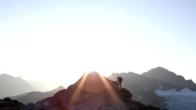 mountaineers approach rugged summit at dawn - moving up stock videos & royalty-free footage