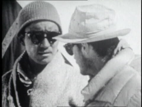mountaineers conferring and smoking a cigarette on mount everest's slopes / nepal - tenzing norgay stock videos & royalty-free footage