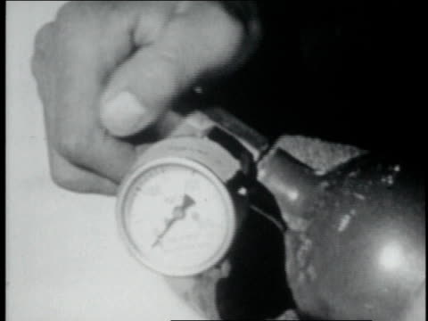 mountaineers holding oxygen tanks / hand turning a valve, meter showing - tenzing norgay stock videos & royalty-free footage