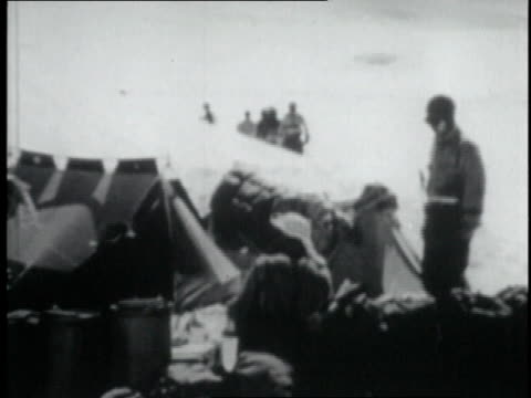 stockvideo's en b-roll-footage met mountaineers leaving base camp at beginning of assault on mt everest / nepal - tenzing norgay