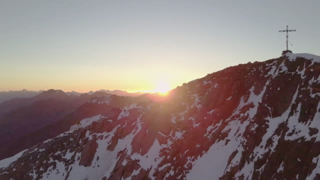 mountaineers on a ridge at sunrise - two people stock-videos und b-roll-filmmaterial