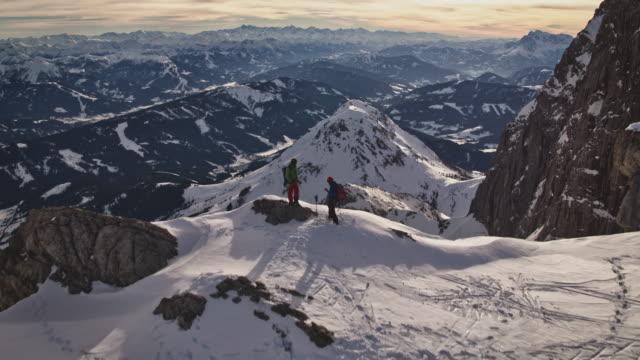 stockvideo's en b-roll-footage met bergbeklimmers die zich voorbereiden op bergbeklimmen - austria