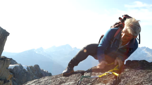 mountaineers sets anchor on mountain summit - one mature man only stock videos & royalty-free footage