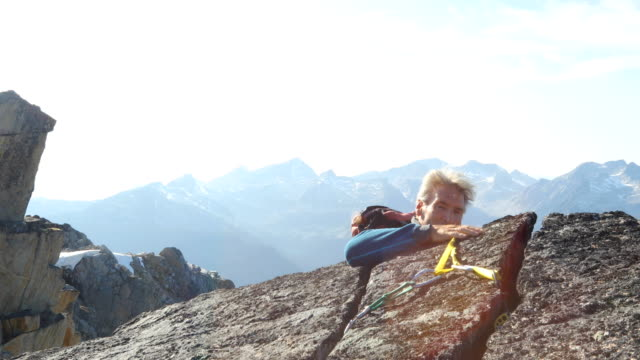 mountaineers sets anchor on mountain summit - abseiling stock videos & royalty-free footage