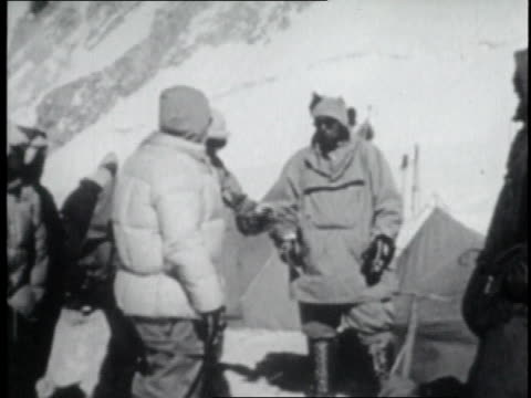 stockvideo's en b-roll-footage met montage mountaineers speaking at base camp on mount everest's lower slopes / nepal - tenzing norgay