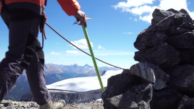 Mountaineers traverse ridge above glaciated mountains
