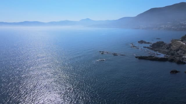 mountains and coast aerial view at sunrise. - litoral stock videos & royalty-free footage