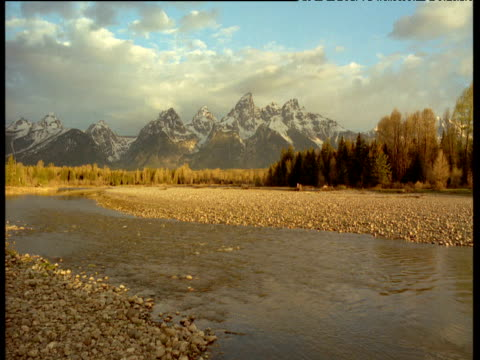 mountains and river at sunrise, teton range, wyoming - grand teton stock videos & royalty-free footage
