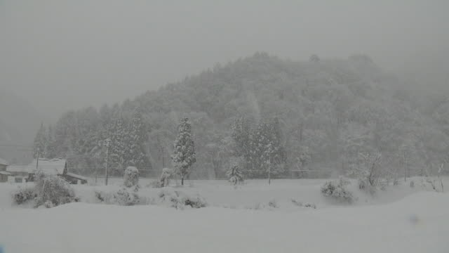 mountains and road in heavy snow, fukushima, japan - road closed sign stock videos & royalty-free footage