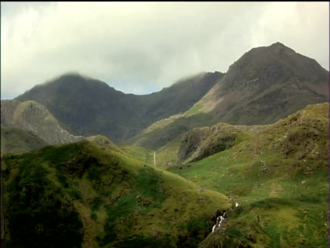 mountains and valleys of snowdonia national park with cloud above - snowdonia stock videos & royalty-free footage