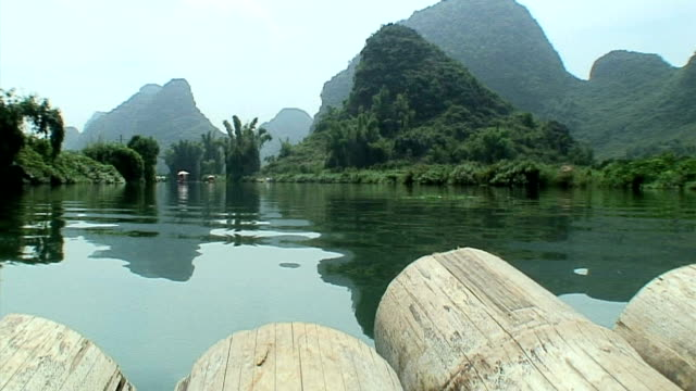 ws la pov mountains as seen from floating raft, yangshuo, guangxi, china - yangshuo stock videos & royalty-free footage