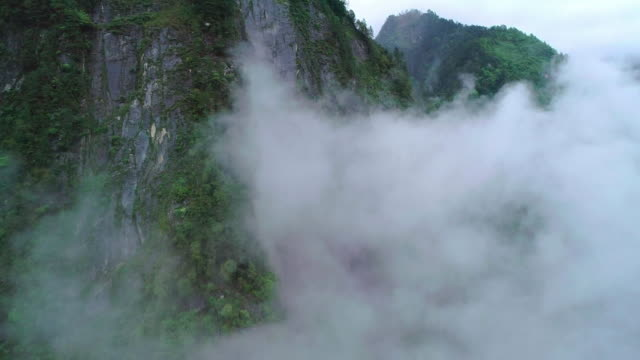 mountains covered in fog in sichuan china - mountain range stock videos & royalty-free footage