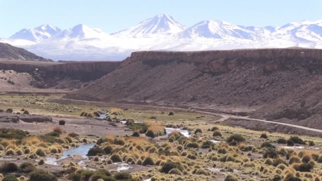 mountains in chile's atacama desert are covered with snow an unusual sight in the world's driest desert - antofagasta region stock videos and b-roll footage