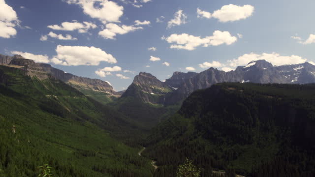 mountains in glacier national park time lapse - glacier national park us stock videos and b-roll footage