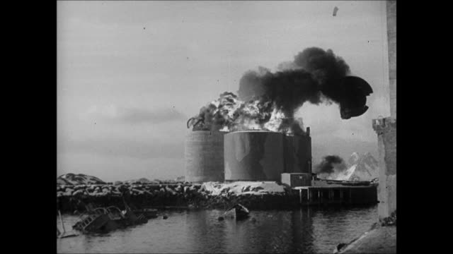WS Mountains Norway LA WS English Norwegian soldiers up ladders to ship MS Norway flag WS Bombed Nazi post WS Exploding oil tanks refinery
