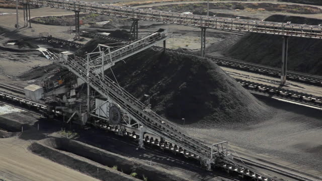 mountains of coal in a stockpile - coal mine stock videos & royalty-free footage