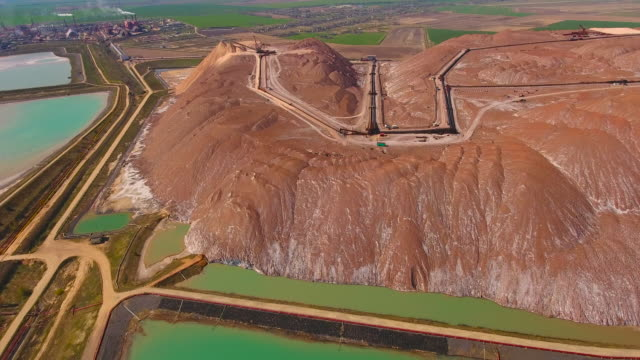 mountains of potassium salt. aerial view. extraction of salt from the mine. - potassium stock videos & royalty-free footage