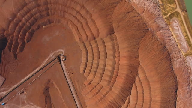mountains of potassium salt. aerial view. extraction of salt from the mine. - mine stock videos & royalty-free footage