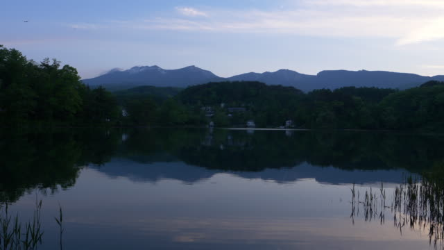 mountains reflected in a lake - nagano prefecture stock videos and b-roll footage