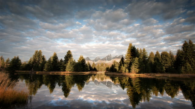 mountains reflected in river, grand teton national park, wyoming - grand teton stock-videos und b-roll-filmmaterial