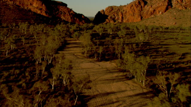 mountains rise on both sides of a valley. - northern territory australia stock videos & royalty-free footage