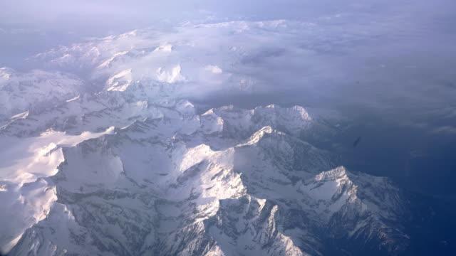 Mountains through a window of an airplane