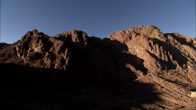 Mountains tower over Saint-Catherine's Monastery in Egypt. Available in HD.