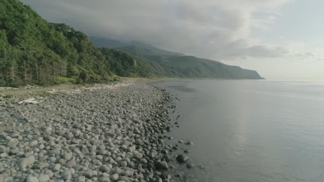 vidéos et rushes de mountainscape and seascape of shiretoko, japan - littoral