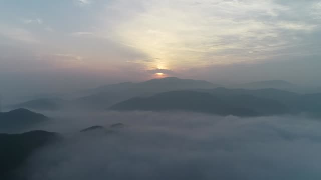 mountainscape covered with clouds, yeongwolgun, gangwon-do province - pink stock videos & royalty-free footage