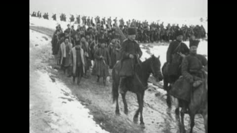 mounted cherkas of the russian caucasus army approach on muddy road; snow lies on both sides of road; infantrymen follow / rear shot infantrymen,... - image stock-videos und b-roll-filmmaterial