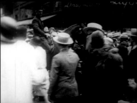 b/w 1926 mounted police controlling crowd at rudolph valentino's funeral / nyc / newsreel - herbivorous stock videos & royalty-free footage