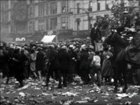 pan mounted policeman herding crowd on nyc street at rudolph valentino's funeral / newsreel - herbivorous stock videos & royalty-free footage